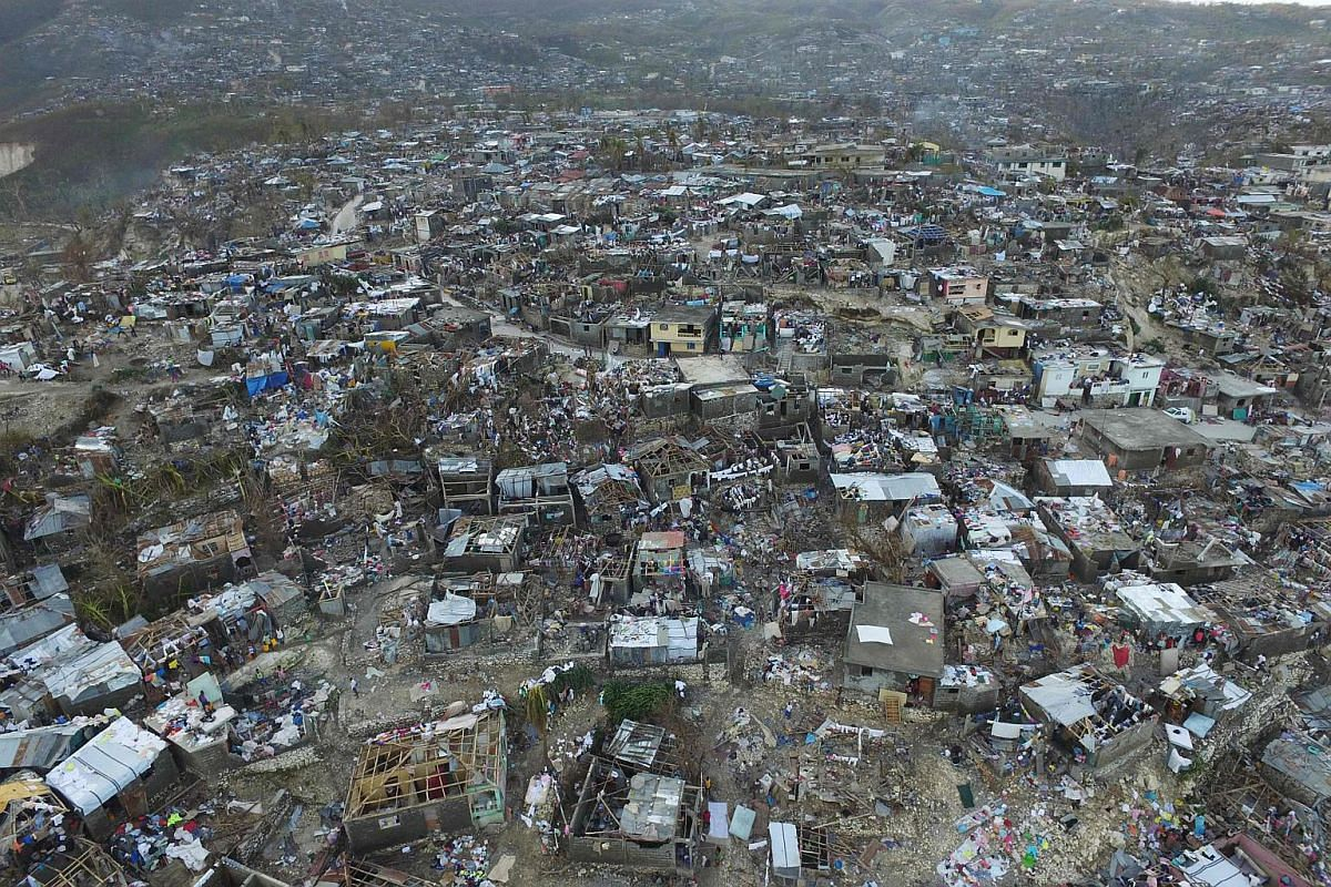 Homes destroyed and damaged by Hurricane Matthew are seen in Jeremie, in western Haiti, on Oct 7.