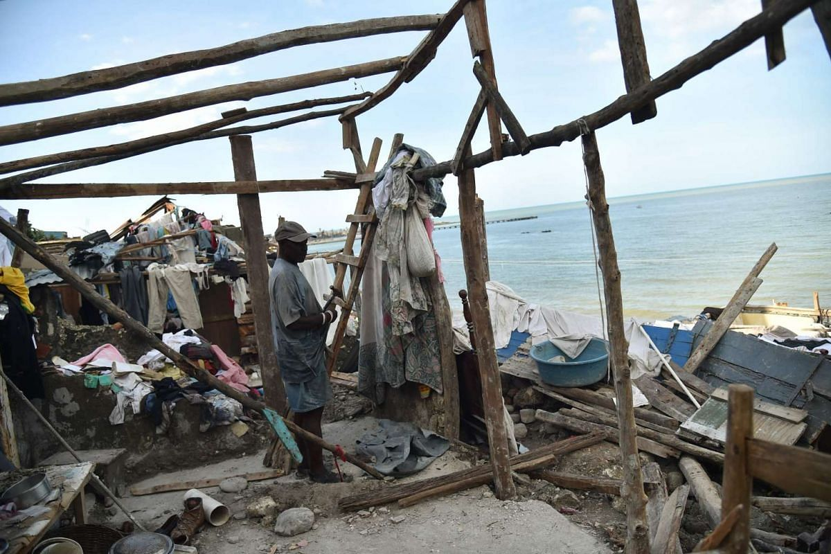 A man starting repairs on his home destroyed by Hurricane Matthew, in Jeremie, in western Haiti, on Oct 7.