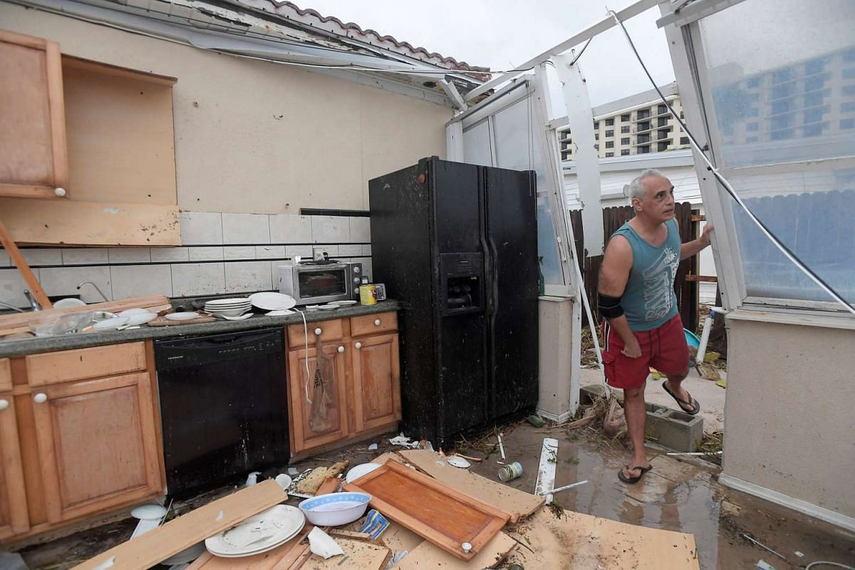 Homeowner Joe Lovece surveying the damage to the kitchen at the back of his oceanfront home after the eye of Hurricane Matthew passed Ormond Beach, Florida, US, on Oct 7.