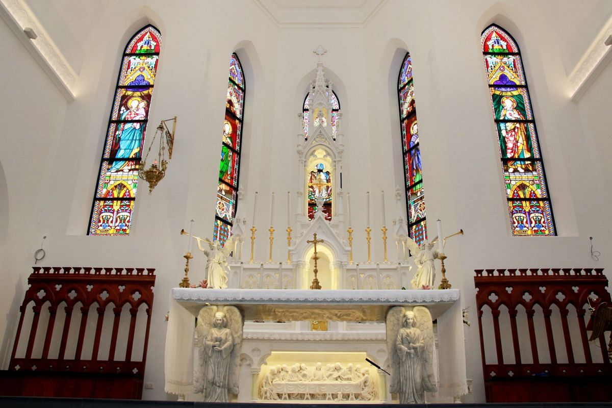 The Church of Saints Peter & Paul, with its new Peranakan-inspired tiles and white carrara marble altar (above).