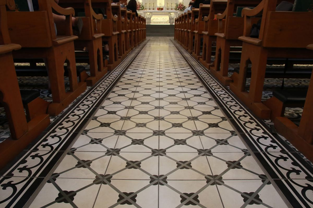 The Church of Saints Peter & Paul, with its new Peranakan-inspired tiles (above) and white carrara marble altar.