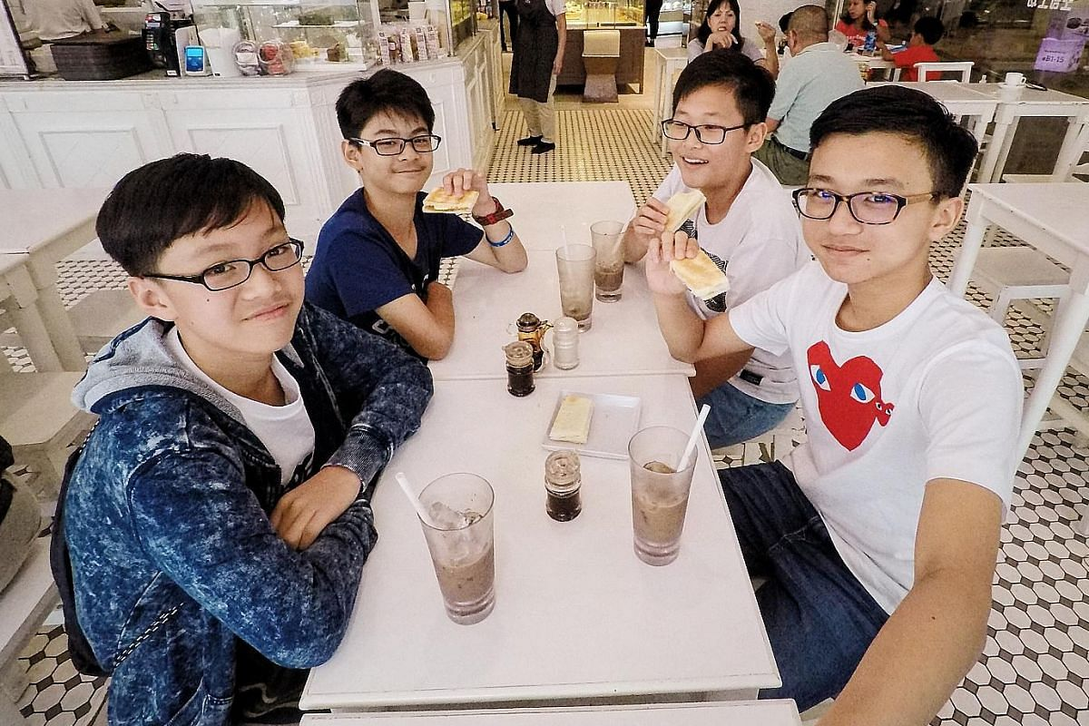 When Krysh Chainani (centre) took his PSLE, the whole family (from far left) sister Kyana, mum Meiling Wong-Chainani and dad Tarun Chainani, rallied around him. Seth Cheong (left, in T-shirt with heart-shape print) celebrating with his friends after
