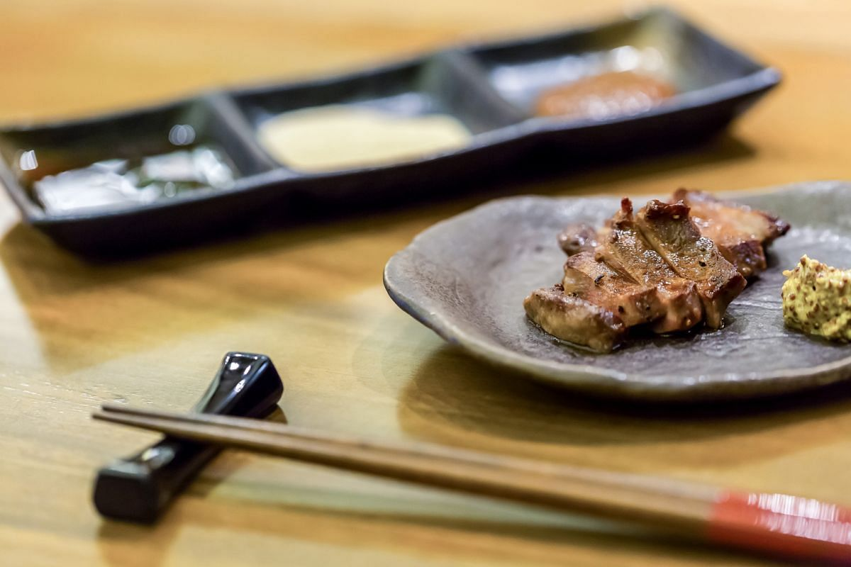 Try the wagyu kushi omi (above) and the hotate, which is grilled in its shell.