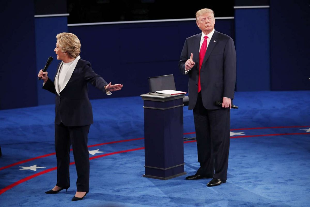 Donald Trump and Hillary Clinton during their second presidential debate at Washington University in St. Louis, October, 9, 2016. PHOTO: THE NEW YORK TIMES