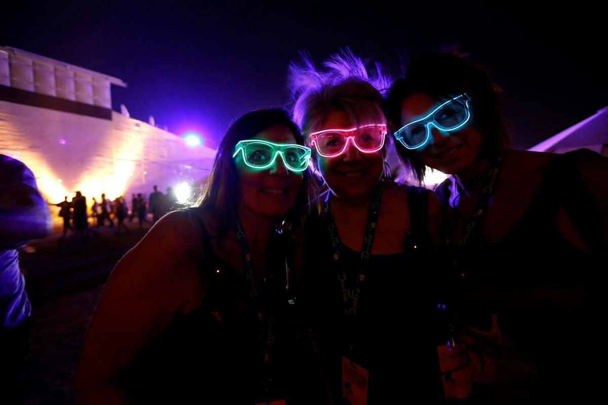 Concertgoers Michelle Amaradio (L), Jo-Ann Walsh (C) and Cami Kelley pose for a photo at Desert Trip music festival at Empire Polo Club in Indio, California U.S., October 9, 2016. PHOTO: REUTERS