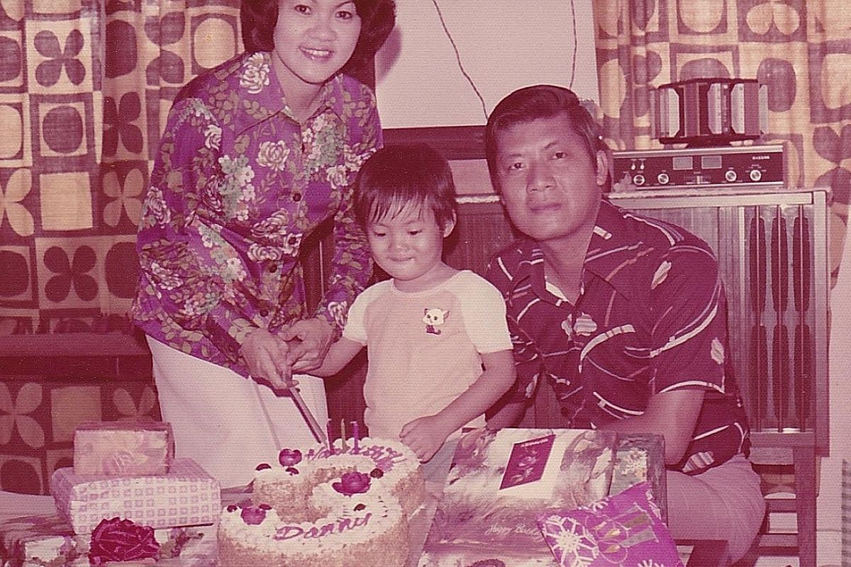 My life so far: Danny Yeo, three, with his father Yeo See Ann and mother Low Yin Fong at his birthday party (above), and at age six with his younger brother Jason.