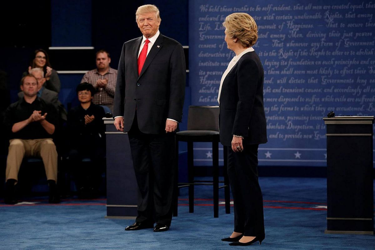 Republican US presidential nominee Donald Trump and Democratic US presidential nominee Hillary Clinton appear together during their presidential town hall debate at Washington University in St. Louis, Missouri, US, on Oct 9, 2016.