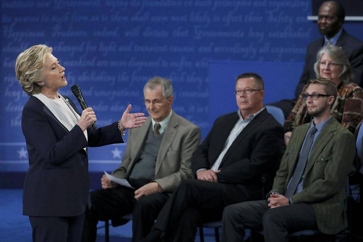 Democratic US presidential nominee Hillary Clinton makes her opening remarks at the start of the second US presidential town hall debate between Clinton and Republican US presidential nominee Donald Trump at Washington University in St. Louis, Missou