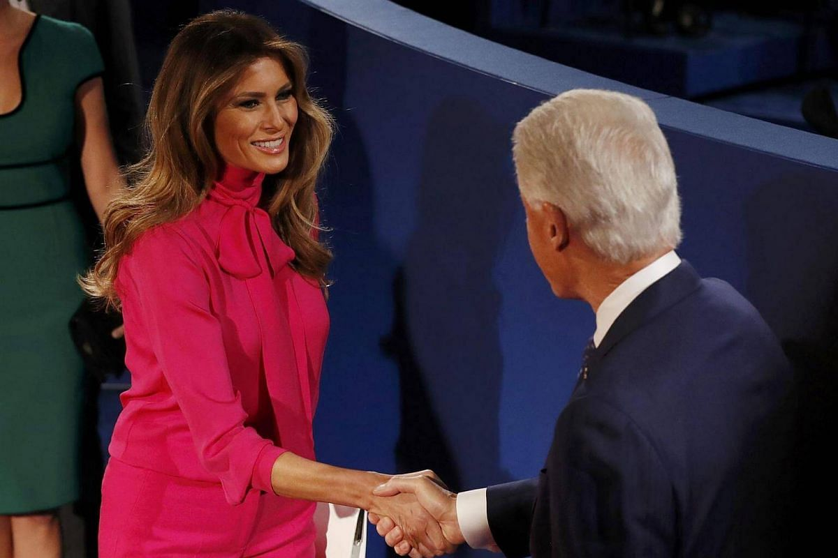Former US President Bill Clinton greets Melania Trump before the town hall debate between Republican US presidential nominee Donald Trump and Democratic US presidential nominee Hillary Clinton at Washington University in St. Louis, Missouri, US, on O
