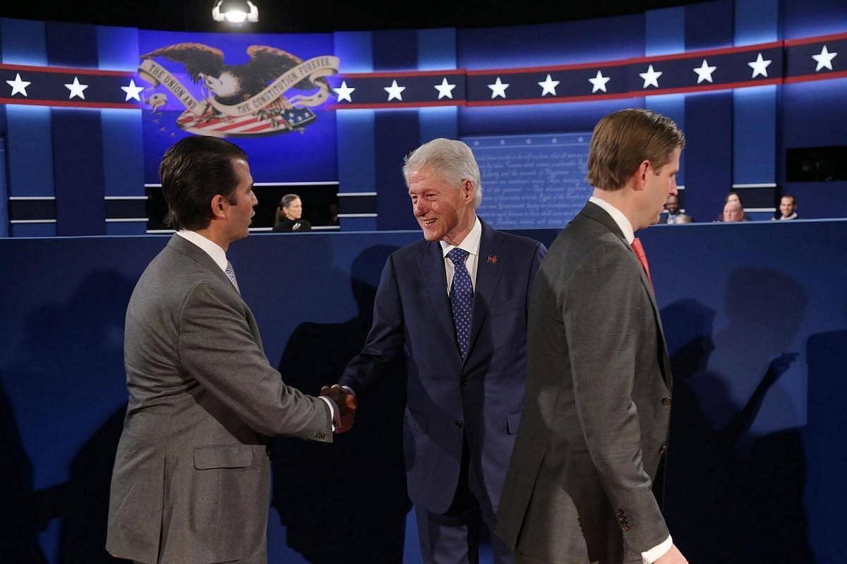 Former US President Bill Clinton (right) and Donald Trump Jr. (left) shake hands at the start of the second Presidential Debate at Washington University in St. Louis, Missouri, US, on Oct 9, 2016.