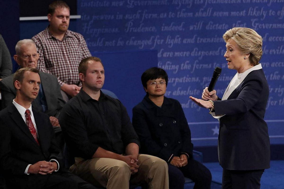 Democratic US presidential nominee Hillary Clinton speaks near members of the audience during the presidential town hall debate with Republican US presidential nominee Donald Trump at Washington University in St. Louis, Missouri, US, on Oct 9, 2016.
