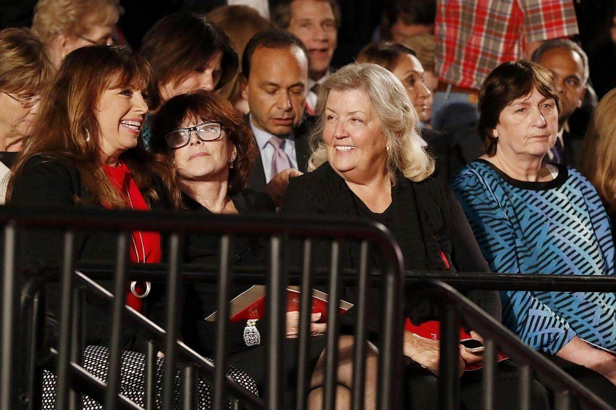 (From left) Paula Jones, Kathleen Willey, Juanita Broaddrick and Kathy Shelton sit at the presidential town hall debate between Republican US presidential nominee Donald Trump and Democratic US presidential nominee Hillary Clinton at Washington Unive