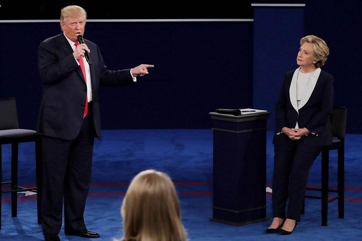 Republican presidential nominee Donald Trump (left) points at Democratic presidential nominee former Secretary of State Hillary Clinton during the town hall debate at Washington University on Oct 9, 2016.