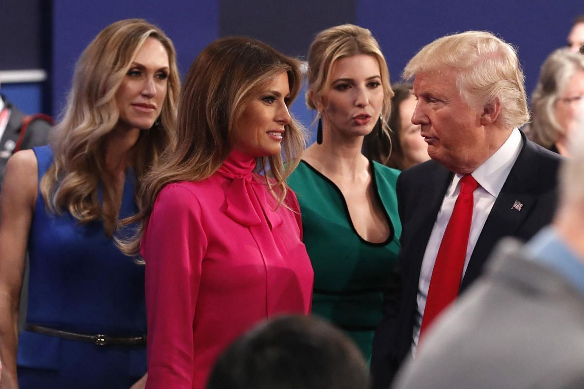Republican nominee Donald Trump discusses with his daughter Ivanka Trump, his wife Melania Trump (second left), and his daugher-in-law Lara Yunaska (left) after the second presidential debate at Washington University in St. Louis, Missouri, on Oct 9,