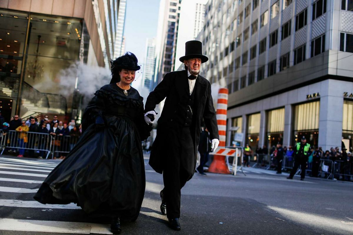 Revellers dressed as Abraham Lincoln and his wife Mary Ann Lincoln take part in the 72nd Annual Columbus Day Parade in New York on Oct 10, 2016.
