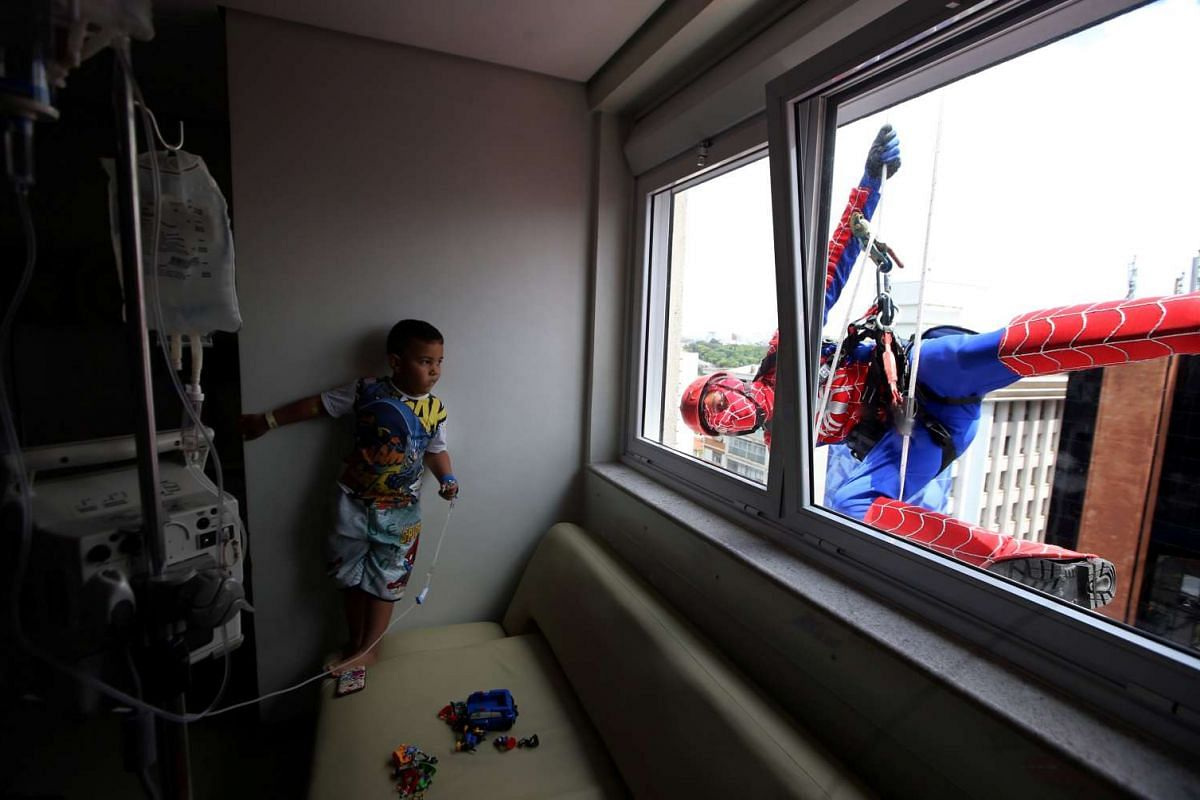 A man dressed as Spiderman jokes with patient Matheus at Hospital Infantil Sabara in Sao Paulo, Brazil, on Oct 10, 2016.