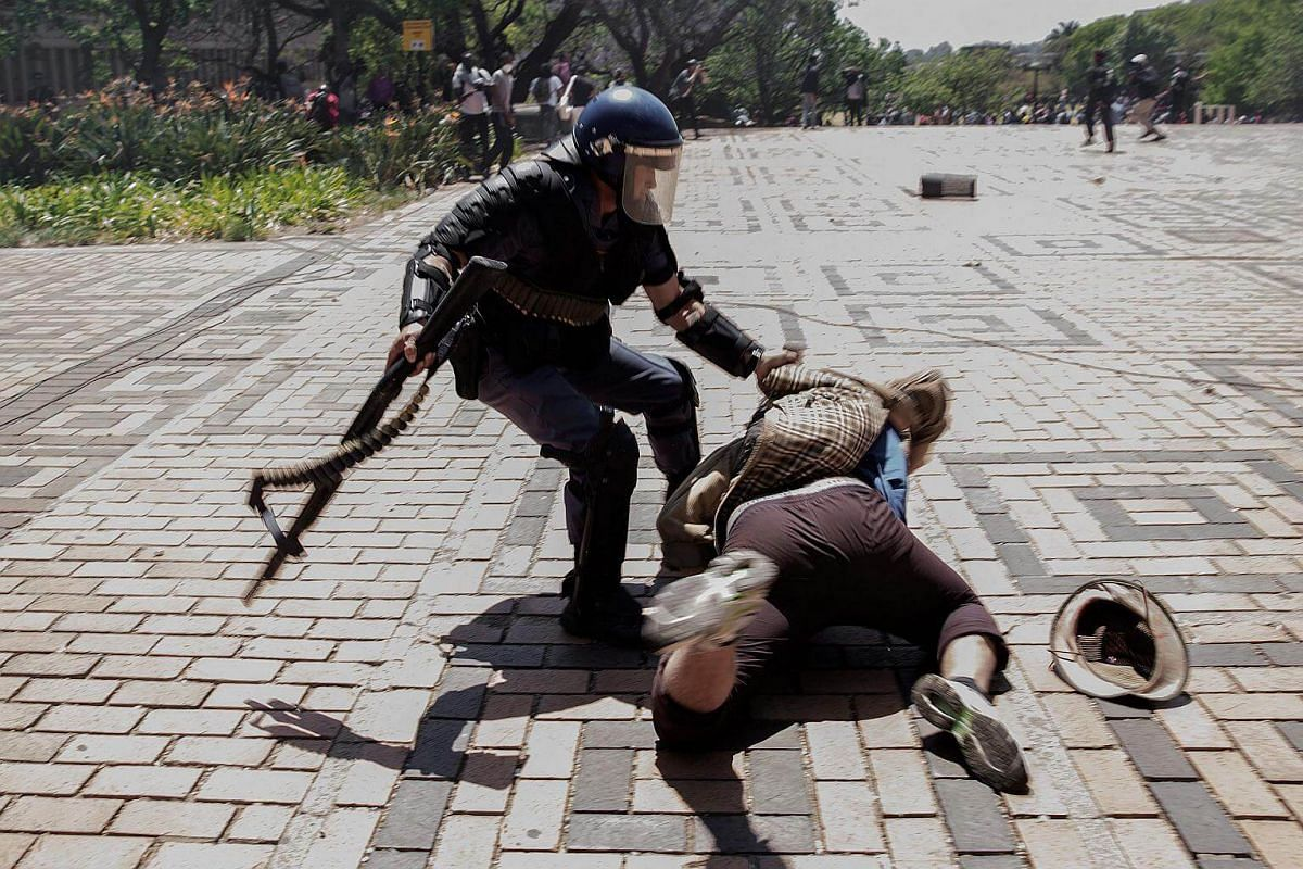 A South African policeman tries to apprehend a student from the University of Witwatersrand.
