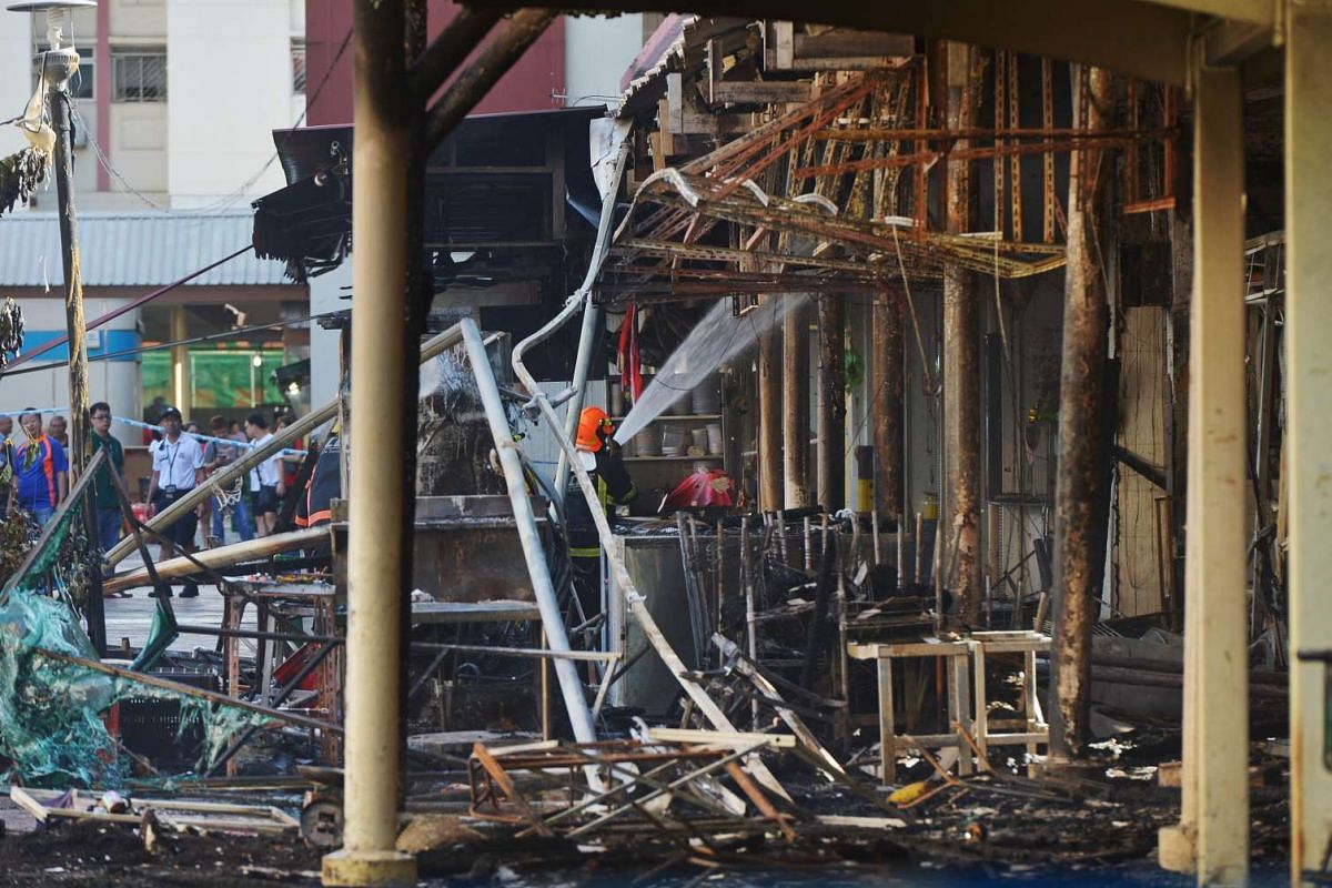 A huge fire engulfed the wet market and coffee shop at Block 493 Jurong West Street 41 early on Tuesday morning, forcing the evacuation of 300 residents from the surrounding area.