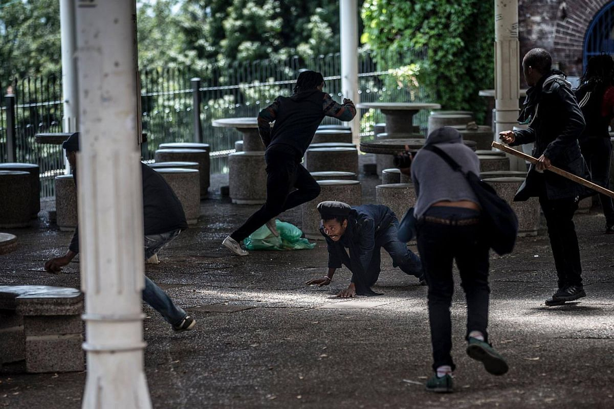 A student falls while taking cover from police rubber bullet fire.