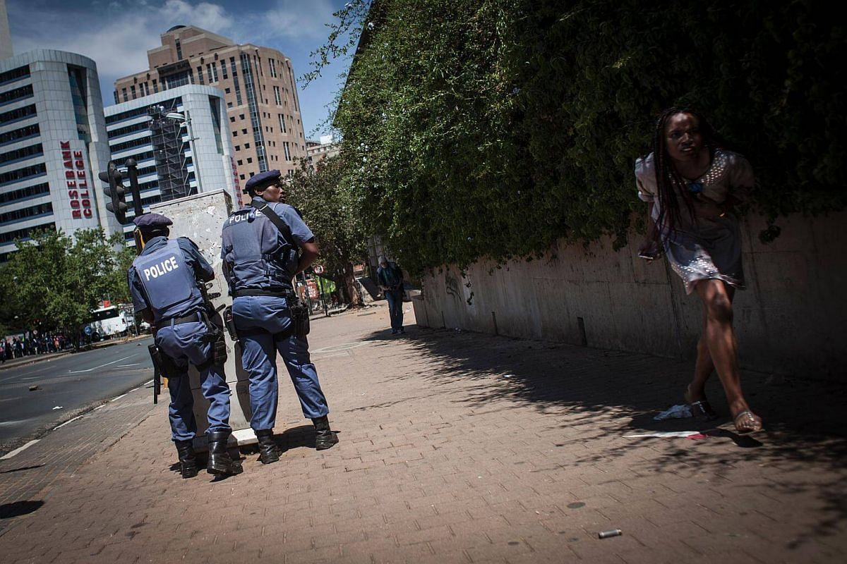 Police disperse protesting students after the FeesMustFall protest spills onto the streets of the Braamfontein district, in Johannesburg.