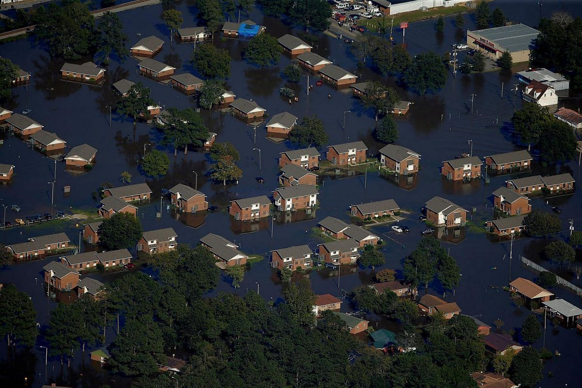 An aerial view shows a neighborhood that was flooded after Hurricane Matthew in Lumberton, North Carolina, on Oct 10, 2016.