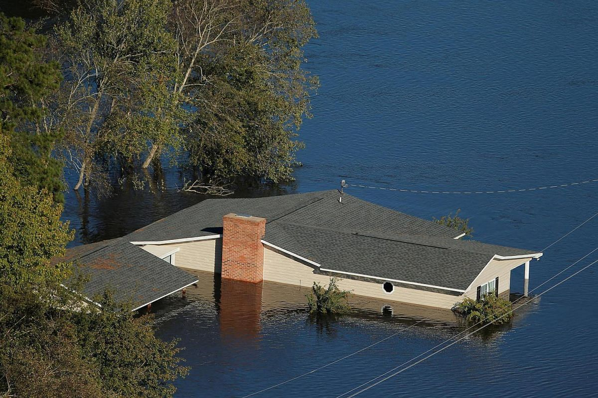A home is seen under water after Hurricane Matthew in Lumberton, North Carolina, on Oct 10, 2016.