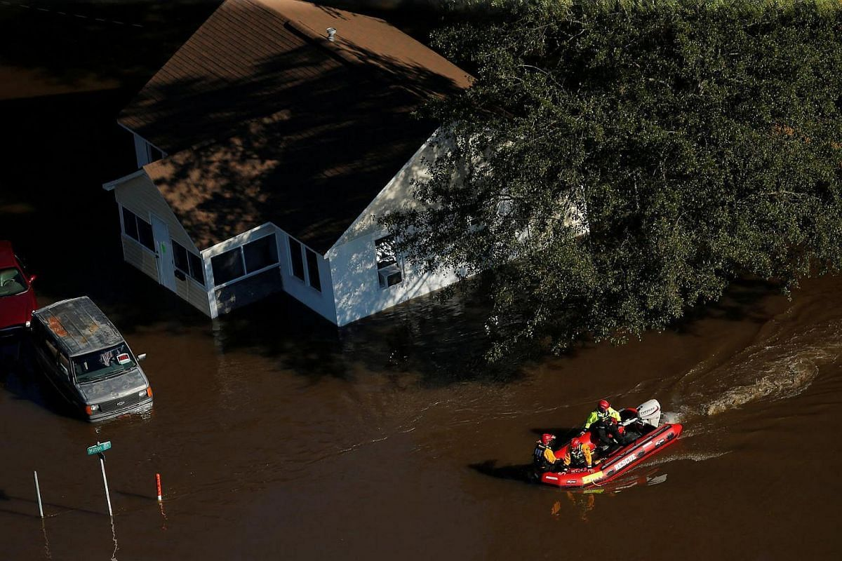 A swift water rescue team is seen making its way through a flooded area after Hurricane Matthew in Lumberton, North Carolina, on Oct 10, 2016.