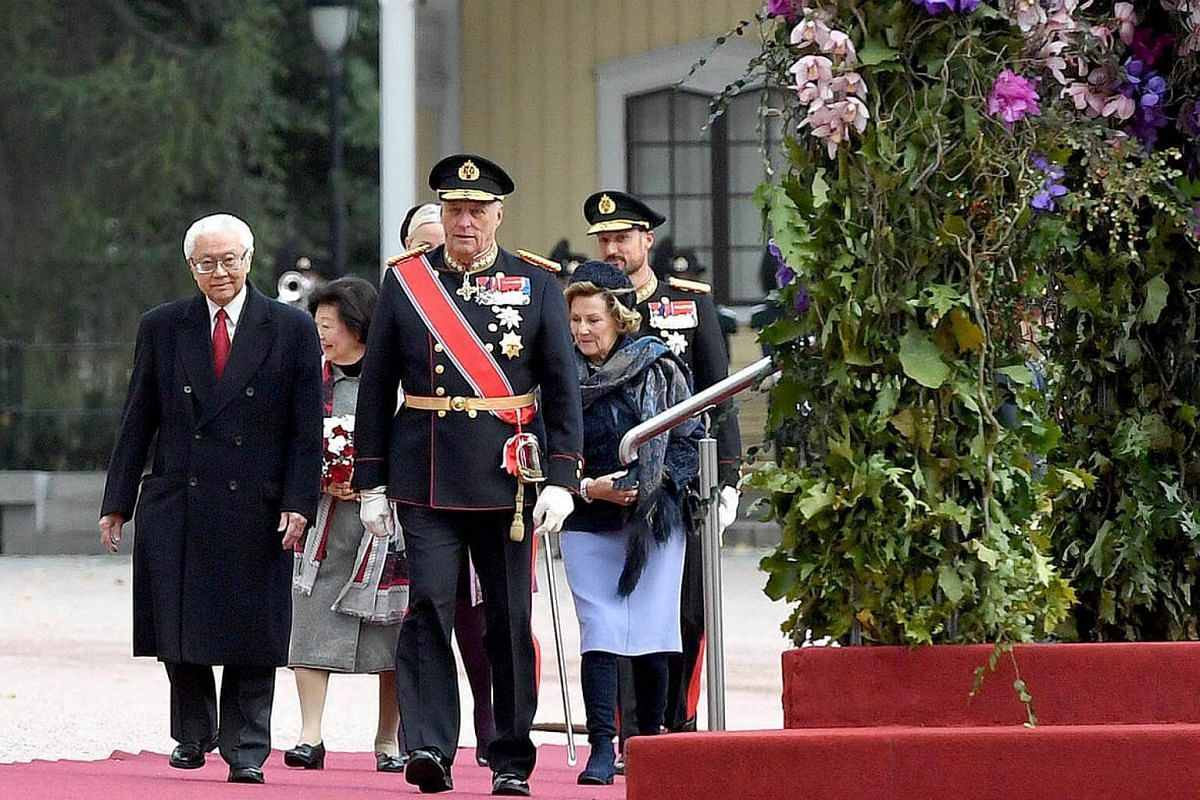 President Tony Tan (left) with King Harald V arriving at the royal palace for the welcome ceremony in Oslo, on Oct 10, 2016.