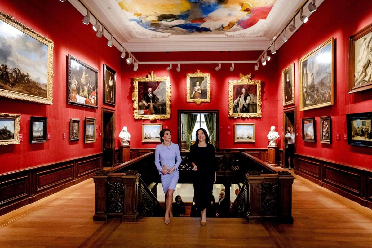 Britain's Catherine, Duchess of Cambridge, looks at paintings as she visits with Mauritshuis' museum director Emilie Gordenker the Mauritshuis art museum in The Hague, the Netherlands, on October 11, 2016, during her first official foreign trip. PHOT
