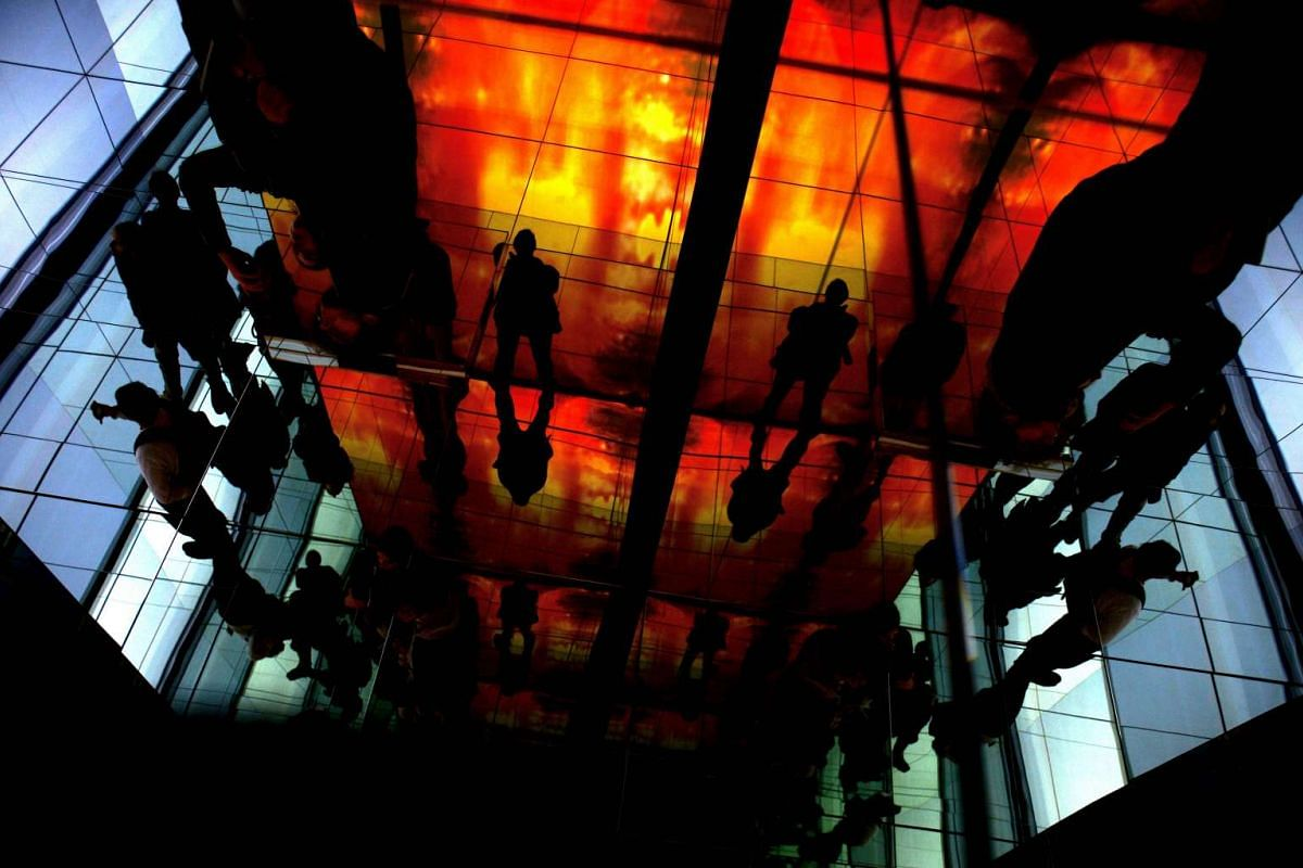 """Visitors visit """"Deep Dream _Act II"""" installation at Macro art gallery, downtown Rome, on October 11, 2016. PHOTO: AFP"""