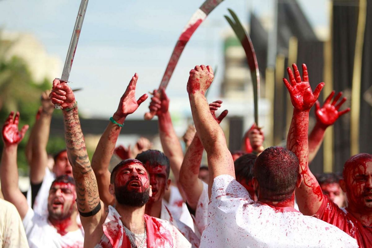 Shi'ite Muslim men gash their foreheads with swords during a religious procession to mark Ashura in Nabatiyeh, southern Lebanon, on Oct 12, 2016.