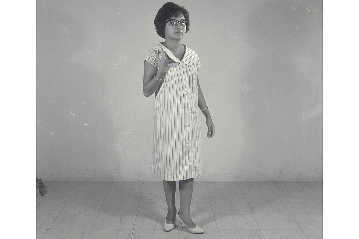 Mrs Goh Soo Sim wears a one-piece maternity suit in striped cotton in 1962. The vertical stripes give the illusion of length and take attention away from the sideways expansion.