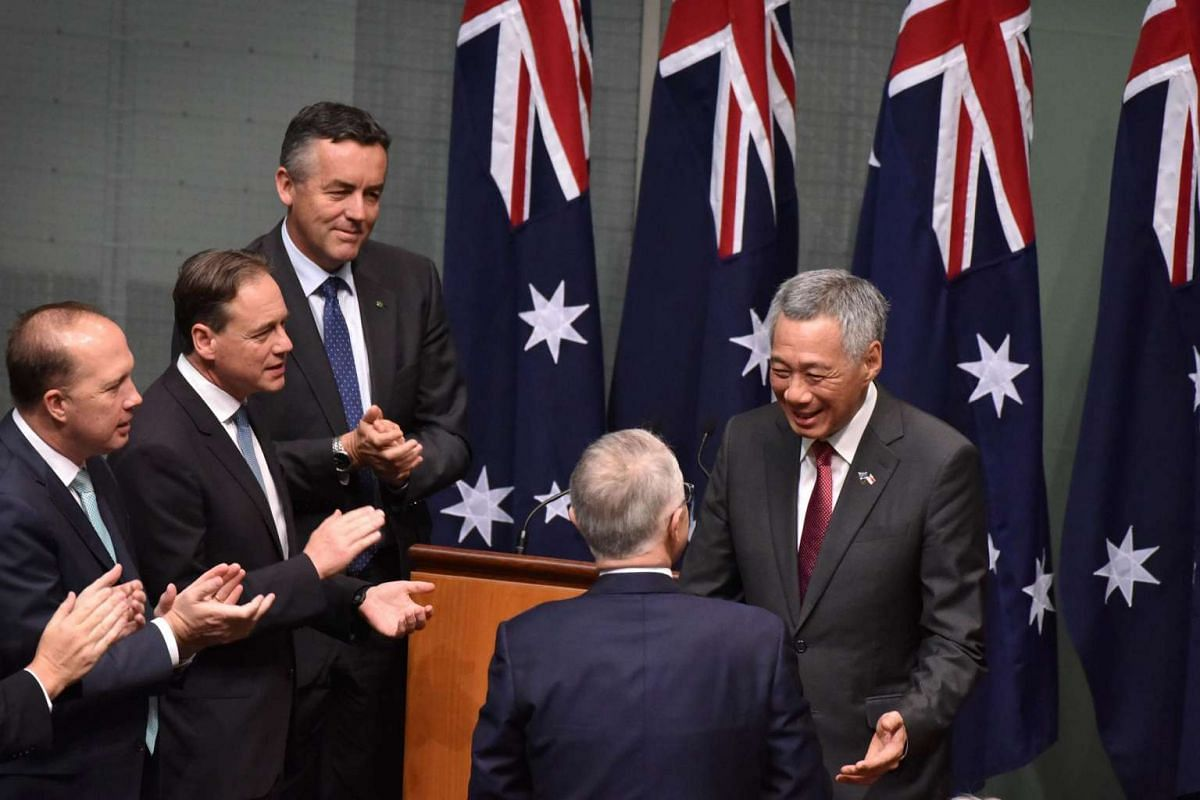 Singapore's Prime Minister Lee Hsien Loong is congratulated by Prime Minister Malcolm Turnbull after speaking to members and senators of the Australian government, Parliament House in Canberra on Oct 12, 2016.
