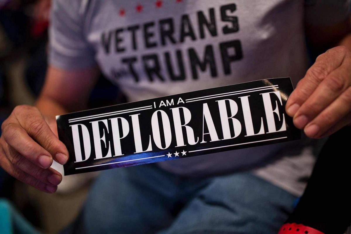 "A supporter of Republican presidential candidate Donald Trump shows a bumper sticker reading ""I am a Deplorable"" at Mohegan Sun Arena in Wilkes-Barre, Pennsylvania on Oct 10, 2016."