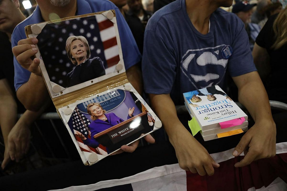 Supporters wait for the arrival of former Secretary of State Hillary Clinton with former Vice President Al Gore as they campaign together at the Miami Dade College - Kendall Campus, Theodore Gibson Center on Oct 11, 2016, in Miami, Florida.
