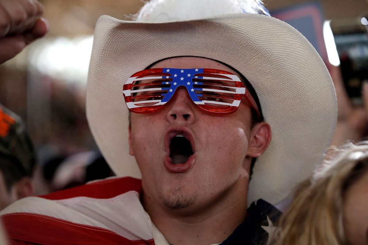 A supporter of Republican US presidential nominee Donald Trump screams as Trump speaks at a campaign rally in Ocala, Florida, US on Oct 12, 2016.