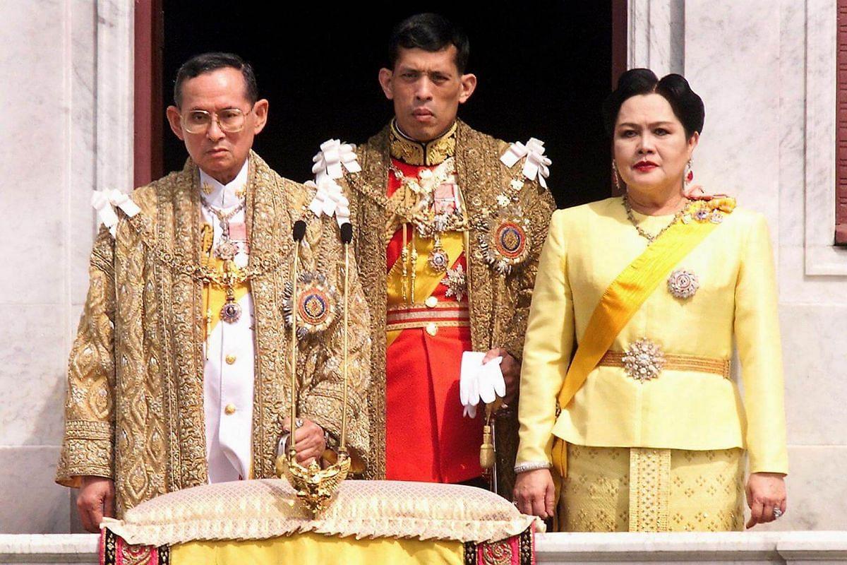 (From left) Thai King Bhumibol Adulyadej, Crown Prince Maha Vajiralongkorn and Queen Sirikit on a balcony of Anantasamakom Throne Hall in Bangkok to mark the King's birthday on Dec 5, 1999.