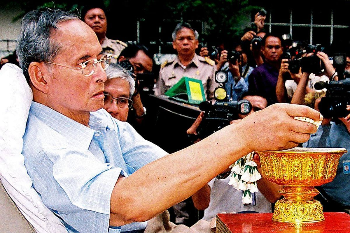 Thai King Bhumibol Adulyadej sitting in a wheelchair during an appearance at a hospital in Bangkok on Oct 23, 2009.