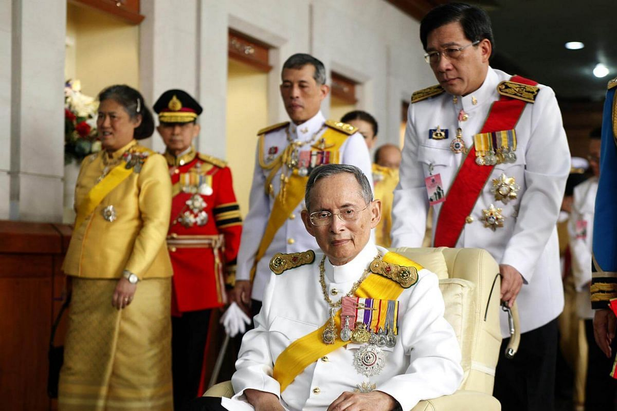 Thai King Bhumibol Adulyadej in a wheelchair as he departs Siriraj hospital to grant an audience on his 85th birthday celebrations in Bangkok on Dec 5, 2012.
