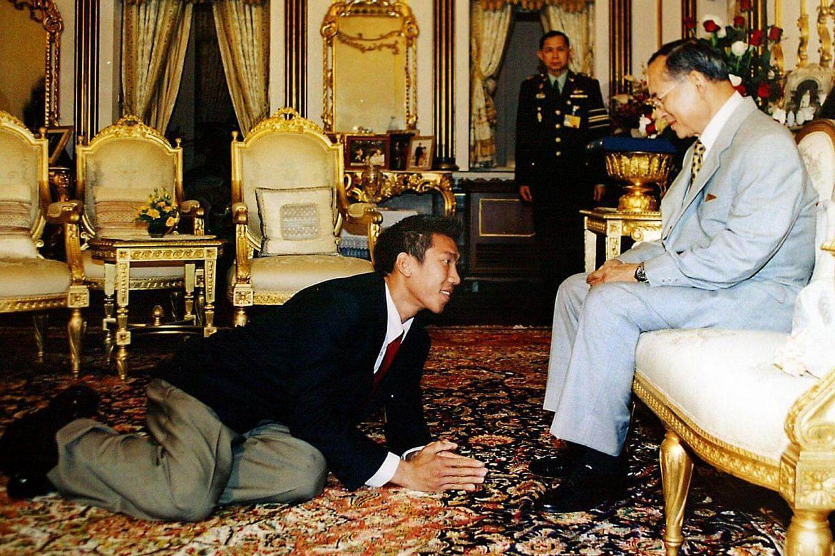 Tennis player Paradorn Srichaphan (left) being granted a royal audience with Thai King Bhumibol Adulyadej at Chitralada Palace in Bangkok on Nov 14, 2002.