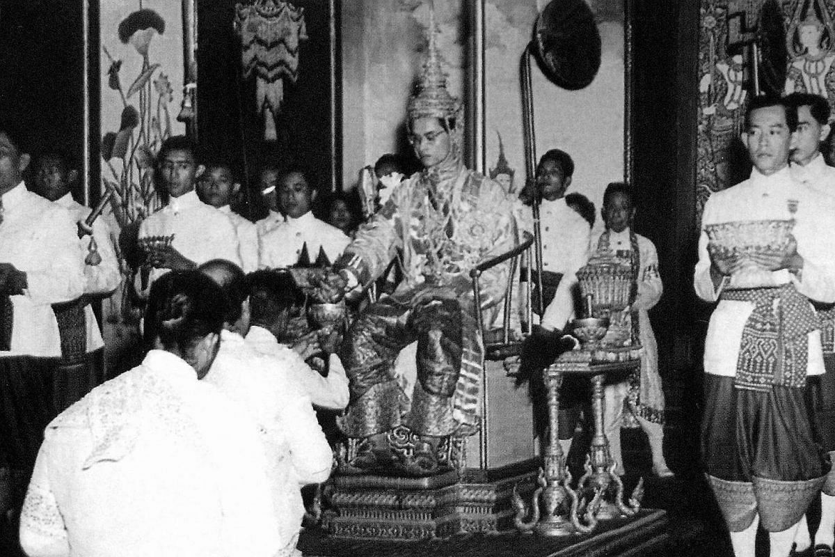 Thai King Bhumibol Adulyadej (centre) on the throne at the Grand Palace in Bangkok.