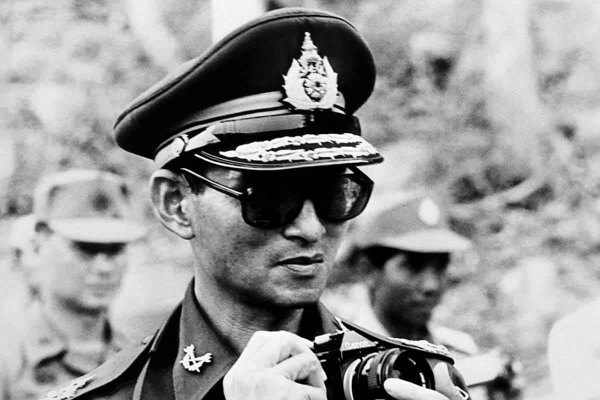 Thai King Bhumibol Adulyadej taking a picture during his trip to Cambodia on July 7, 1980.