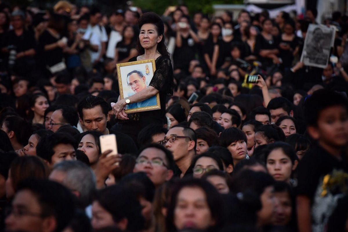 Huge crowds gather outside the Grand Palace in Bangkok to pay their respects to the late King Bhumibol Adulyadej on Oct 14, 2016.