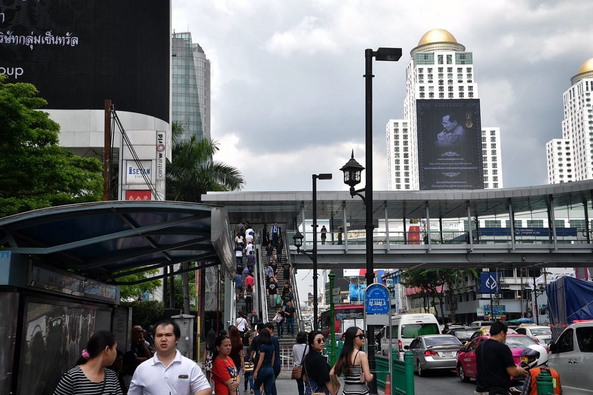 An obituary of the late Thai King is seen on a giant screen near Central World in Bangkok on Oct 15, 2016.