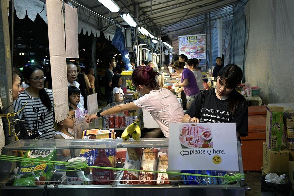 Food stalls at a pasar malam in Serangoon two weeks ago. There are now 10 to 12 night markets here a month, down from 20 to 30 five years ago.