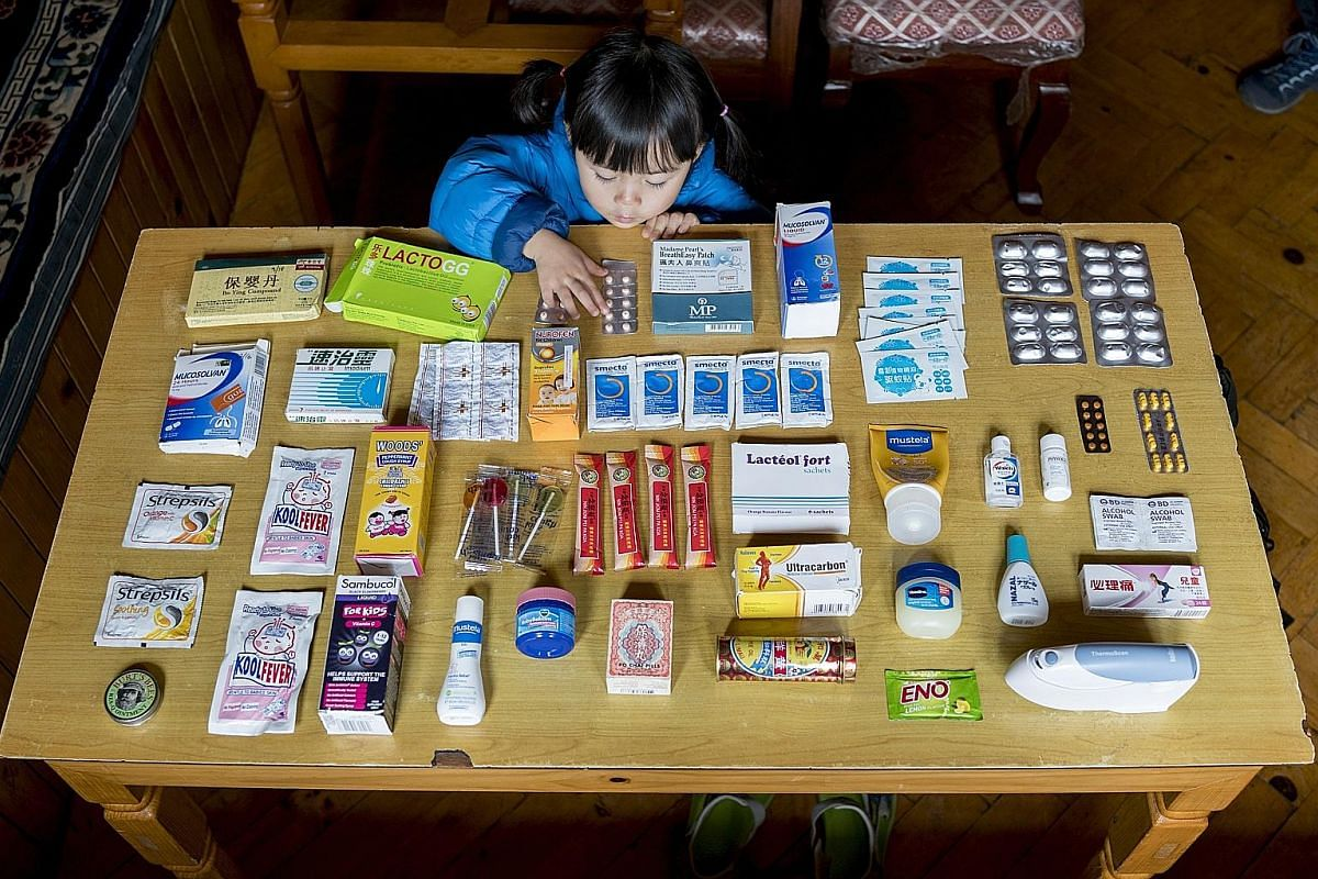 Jiahan (left) with some of the medication which the family took on the trip. Above: Stefen Chow with his three-year-old daughter, Jiahan, at Solukhumbu district in Nepal, en route to Everest Base Camp.