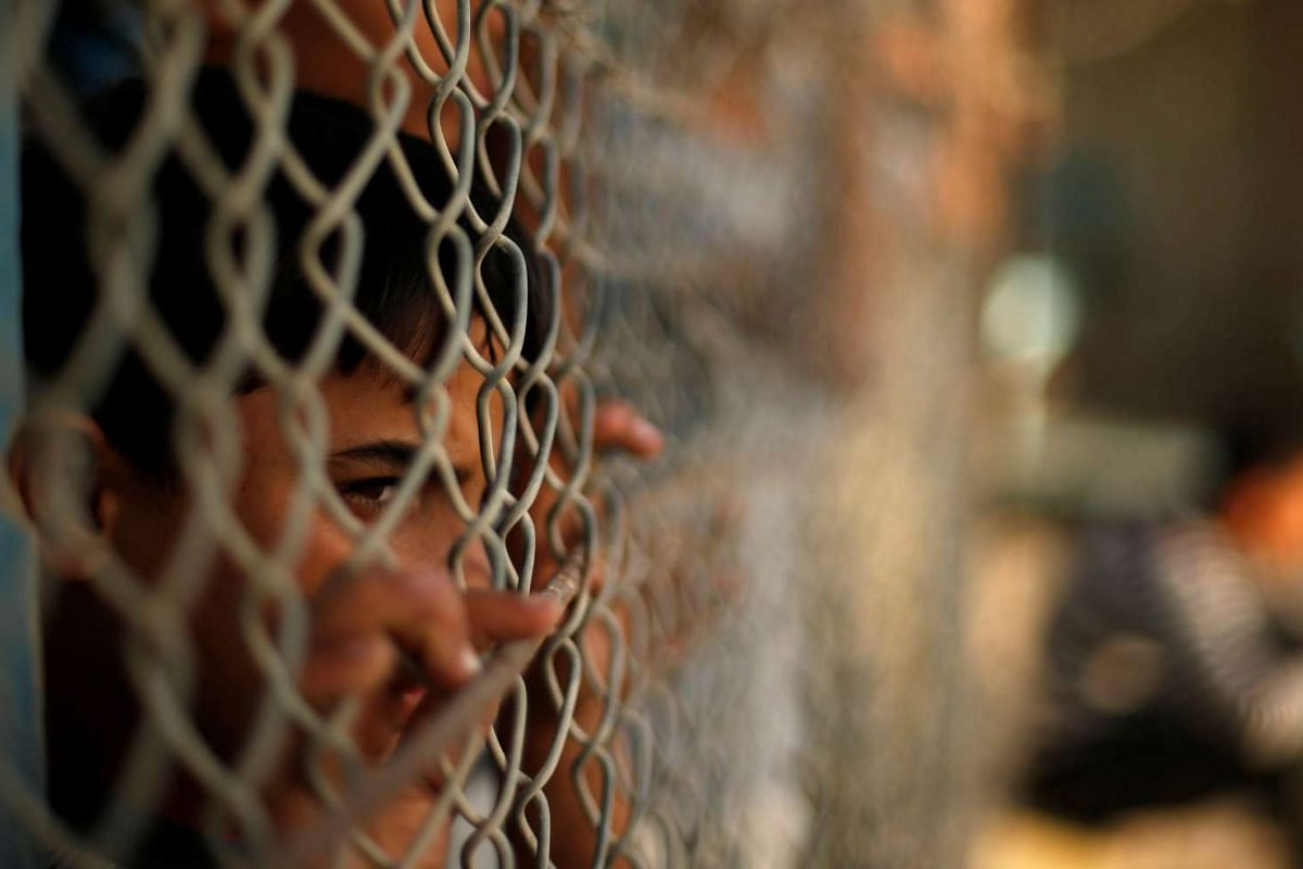 A Palestinian boy in Rafah in the southern Gaza Strip waits for relatives to return to Gaza on Oct 16, 2016, after the Egyptian authorities opened the Rafah border crossing for two days for humanitarian cases.