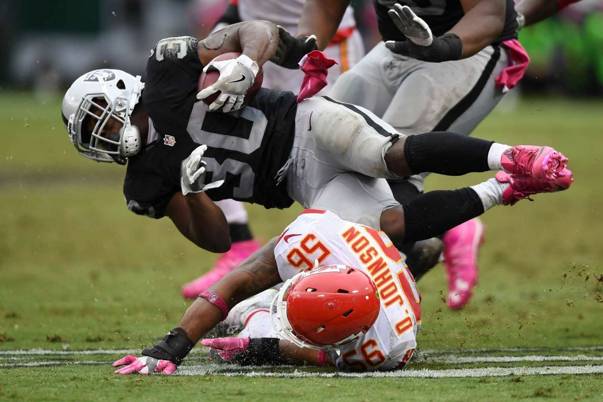 Jalen Richard #30 of the Oakland Raiders is tackled by Derrick Johnson #56 of the Kansas City Chiefs during their NFL game at Oakland-Alameda County Coliseum on Oct 16, 2016 in Oakland, California.