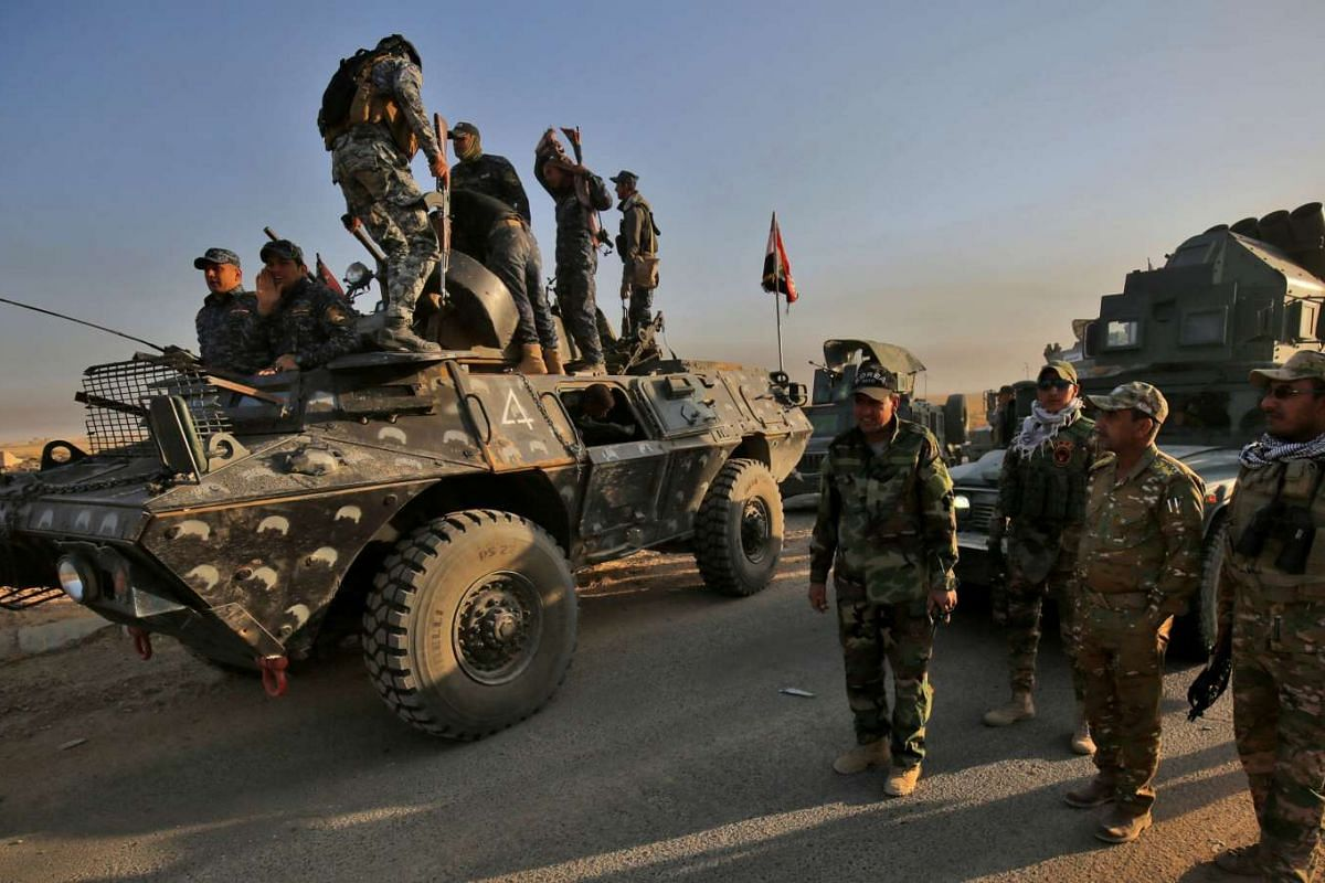 Iraqi forces gather in the area of al-Shourah, south of Mosul on Oct 17, 2016.