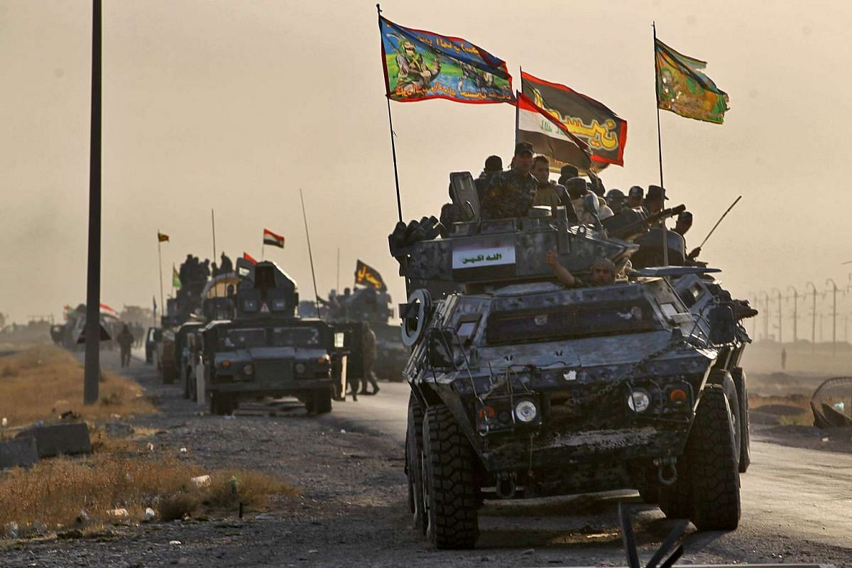 Iraqi forces deploy in the area of al-Shourah, south of Mosul on Oct 17, 2016.